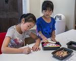 Two young girls drawing