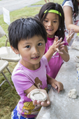 Two kids playing with clay