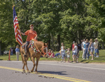 Woman and her horse marching in Petersham's July 4th Parade