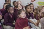 Children listening to a teacher in a classroom