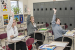 Students raising hands to answer a question