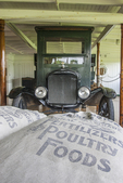 "Old truck and bags of ""poultry foods"" loaded on The Ticonderoga at Shelburne Museum"