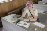 A visitor sitting at one of the desks in the Vergennes Schoolhouse at the Shelburne Museum