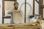 Man at the Shelburne Museum making a basket