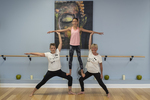 Three yoga students working on a pose.