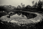 A pond surrounded by a stone wall at the top of Mt Wachusett in Princeton, MA
