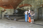 Visitors interested in the cannon in Fort Knox, Prospect, Maine