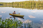 Woman paddling her kayak in Beaver Pond at the Birch Hill Dam recreation area.