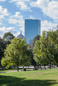 The John Hancock Building in Boston, MA viewed from the Public Garden