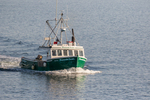 Fishing boat returning to Gloucester Harbor