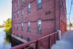 An old factory building in Orange, MA now closedon the Millers River
