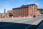 Riveto Mfg. Company located in old factory and mill buildings in Orange, MA