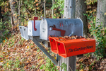 Rural mailboxes and paper tubes in a country town in Massachusetts