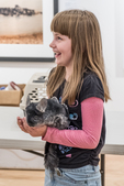 Young girl holding a chinchilla at an animal show for families