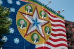 Colorful patriotic mural painted on the side of a building on Foster Street