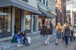 People walking along Main Street in Northampton, MA