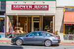 Car parked in front of Zephyr Rug on Main Street in Northampton, MA