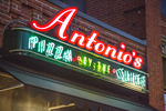 Antonios Pizza sign at night in Amherst, MA