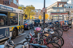 Bus, cars and bikes line are plentiful in the streets of Cambridge, MA