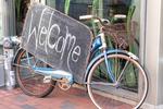 Bike outside a store welcoming customers