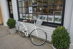 Bicycle parked outside of a store in downtown Concord, MA
