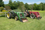 Two tractors at a New England farm