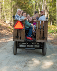 A group going for a wagon ride at the Garlic Festival in Orange, Massachusetts