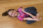 Little girl in a yoga class