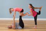 A mom and her two children in a yoga class