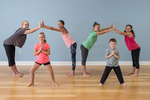 A yoga class with young women and children