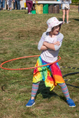 Young girl playing with a hula hoop at the Garlic festival in Orange, MA