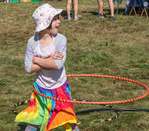 Young girl playing with her hula hoop at the Garlic Festival in Orange, MA
