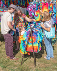 People looking at psychedelic clothing at the Garlic Festival in Orange, MA