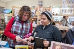Two women shopping at a small store in Massachusetts at Christmas time