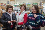 Three women shopping at a small store in Massachusetts at Christmas time