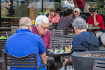 Men playing chess in Harvard Square in the summer