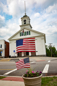 The Barre, Massachusetts Town Hall with a huge American flag covering the front of the building