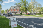 A VOTE sign prominently displayed on the Town Common in Grafton, MA
