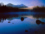 LF 194.   Reflections of sunrise, a light shaft, fog and the Three Sisters from Scott Lake at sunrise.  Three Sisters Wilderness, OR