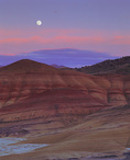 MF 120.  Full moonrise at dusk over the Painted Hills.  John Day Fossil Beds National Monument, OR