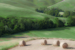 D3X 39.  Baled hay atop a plateau amidst rolling hills in a rural farming belt of Tuscany, Italy