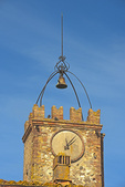 D3X 66.  A remote village church and bell tower with an ornate, decaying clock and sculptural bell mount rusting away.  Near San Vivaldo, Tuscany, Italy