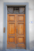 D3X 71.  A once elegant and old door with ornate metal work in downtown Florence.  Tuscany, Italy  