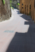 D3X 72.  A street narrows into an alley at the edges of San Gimignano, Tuscany, Italy