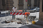D3X 77.  Workers making repairs to a street in downtown Florence, Tuscany, Italy