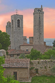 D3X 109.  A colorful early morning sky mingles with some of the rooftops and bell towers of San Gimignano.  Tuscany, Italy