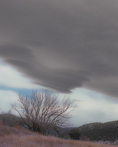 MF 518 PI.  Lenticular clouds form over a wintry northern New Mexico landscape near Ledoux, Mora County.