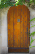 D800e 93 PI.  An artisan, wood door opens to a medieval home in Fontvieille.  Provence, France, Europe.