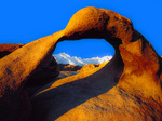 LF 369 PI.  An arch in the Alabama Hills Recreation Area moments after sunrise with Mt. Whitney in the snowy background.  Eastern Sierra, CA
