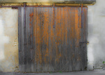 D800e 126 PI.  A weathered and rust stained sliding garage door in St. Remy de Provence. Provence, France, Europe